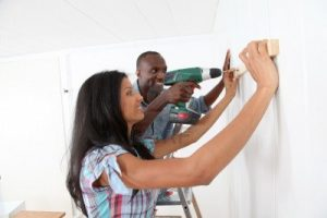 9784577-young-couple-renovating-their-new-house